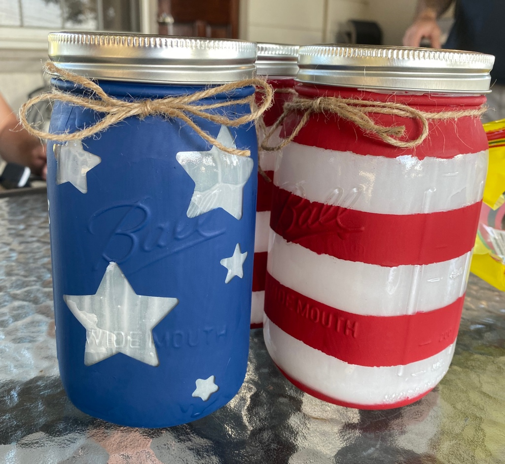 Finished Mason Jars with rims and twine bows.